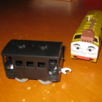 Thomas train coach with damaged hook eye coupling